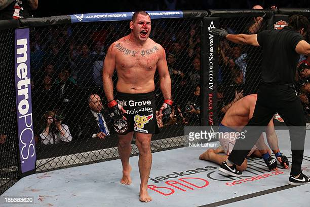 Cain Velasquez celebrates after defeating Junior Dos Santos by TKO after referee Herb Dean calls a stop to the fight in their UFC heavyweight...