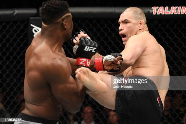 Cain Velasquez kicks Francis Ngannou of Cameroon in their heavyweight bout during the UFC Fight Night event at Talking Stick Resort Arena on February...