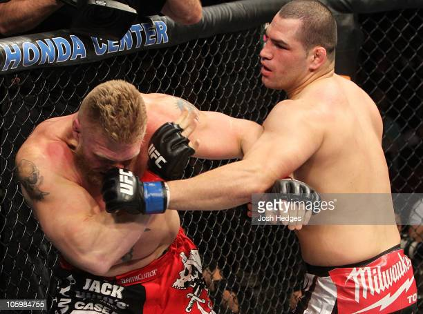 Cain Velasquez throws a punch as Brock Lesnar is against the fence in the first round during the heavyweight title bout during UFC 121 on October 23...