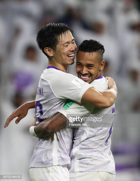 Caio and Tsukasa Shiotani of Al Ain celebrate penalty shoot out victory in the FIFA Club World Cup first round playoff match between Al Ain FC and...