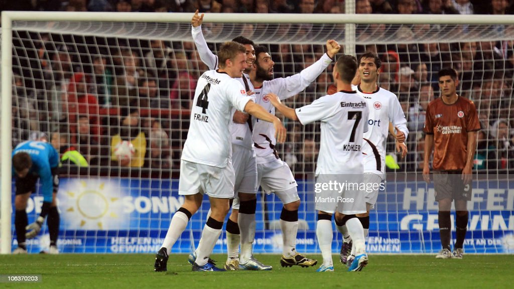 Caio (2nd of left) celebrate after he scores his team's 3rd goal of Frankfurt battle for the ball during the Bundesliga match between FC St. Pauli and Eintracht Frankfurt at Millerntor Stadium on October 30, 2010 in Hamburg, Germany.