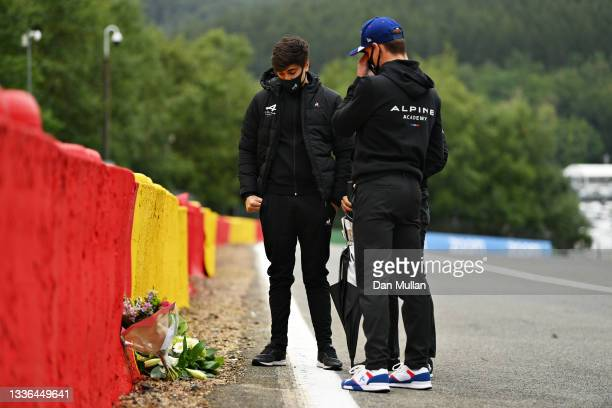 Caio Collet of Brazil and MP Motorsport and Victor Martins of France and MP Motorsport leave flowers at the site of the crash of the late Anthoine...