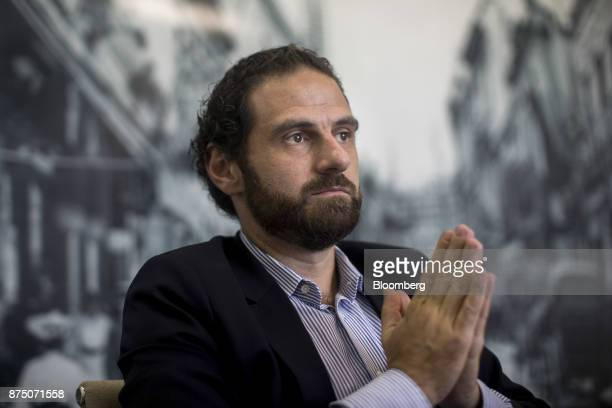 Caio Megale economist with Itau Unibanco SA pauses during an interview in Sao Paulo Brazil on Thursday Nov 16 2017 Brazil's economy started growing...