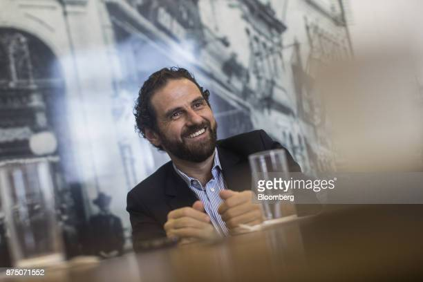 Caio Megale economist with Itau Unibanco SA smiles during an interview in Sao Paulo Brazil on Thursday Nov 16 2017 Brazil's economy started growing...