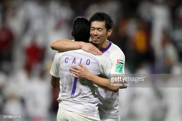 Caio of Al Ain celebrates his team's victory with Tsukasa Shiotani of Al Ain after the FIFA Club World Cup UAE 2018 Second round match between ES...