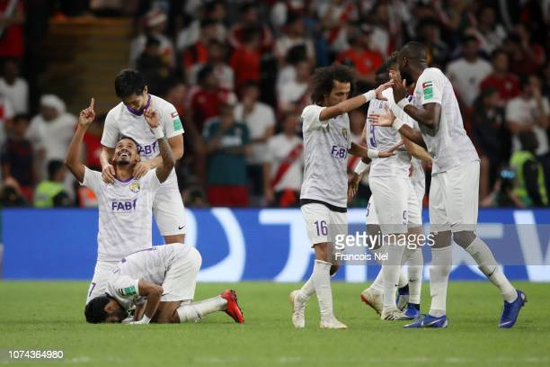 Caio of Al Ain celebrates with teammates after scoring his team's second goal during the FIFA Club World Cup UAE 2018 Semi Final Match between River...