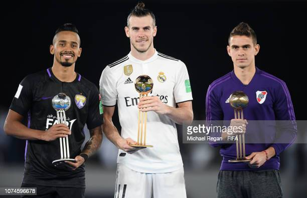 Caio of Al Ain Gareth Bale of Real Madrid and Rafael Santos Borre of River Plate pose with their Adidas Golden Ball awards after the FIFA Club World...