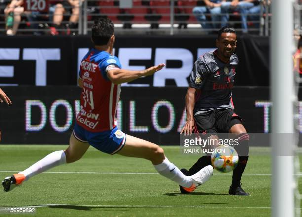 Caio of Benfica takes a shot for goal against Pollo Briseño of Chivas de Guadalajara during their 2019 International Champions Cup match at the...