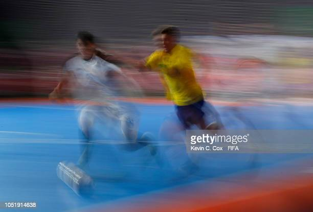 Caio of Brazil pushes the ball ahead of Jafeth Carvajal of Costa Rica in the Men's Group B match between Brazil and Costa Rica during the Buenos...