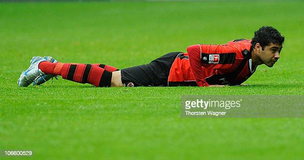 Caio of Frankfurt is lying on the pitch during the Bundesliga match between Eintracht Frannkfurt and VFL Wolfsburg at Commerzbank Arena on November 6...