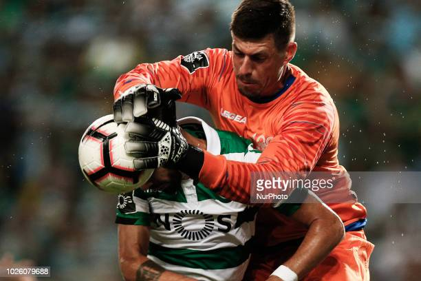 Caio Secco of Feirense vies for the ball with Bruno Fernandes of Sporting during Primeira Liga 2018/19 match between Sporting CP vs CD Feirense in...