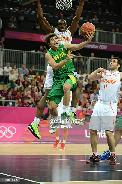 Caio Torres of Brazil shoots against Serge Ibaka of Spain during their Men's Basketball Game on Day 10 of the London 2012 Olympic Games at the...