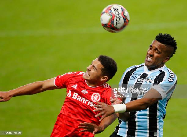 Caio Vidal of Internacional and Bruno Cortez of Gremio fight for the ball during the final of Rio Grande Do Sul State Championship 2021 between...