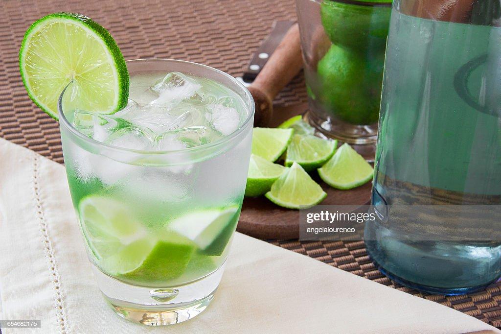 Caipirinha drink and ingredients : Stock Photo