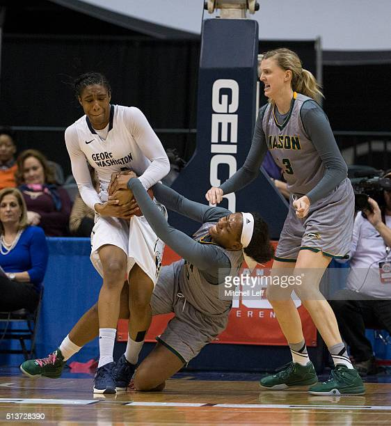 Caira Washington of the George Washington Colonials fights for the ball along with Chinyere Bell of the George Mason Patriots in the Quarterfinals of...