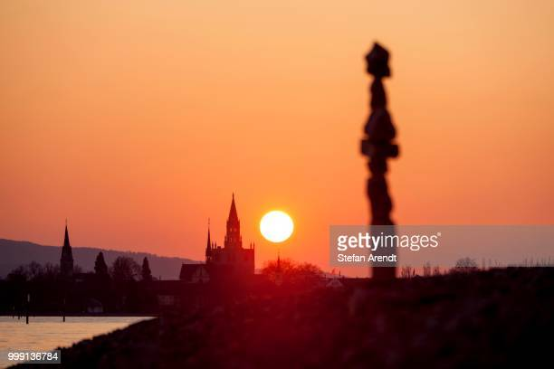Cairn and Constance Cathedral at sunset, on Lake Constance, Baden-Wuerttemberg, Germany, PublicGround