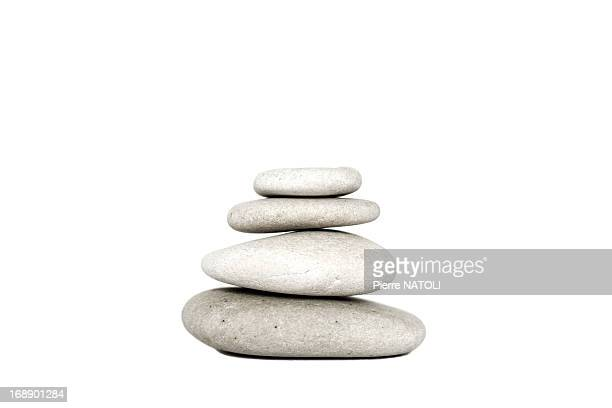cairn of pebbles - pebble stock pictures, royalty-free photos & images