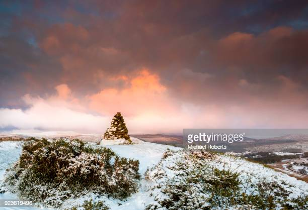 cairn on snow covered hill fort at cwmyoy near abergavenny in the black mountains, brecon beacons national park, wales. - south wales stock pictures, royalty-free photos & images