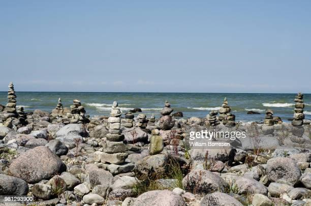 cairn rock stacks on seashore, oland, kalmar county, sweden - エーランド ストックフォトと画像
