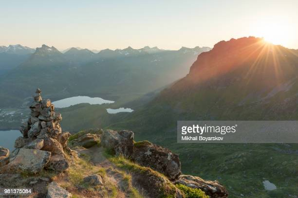 Cairn with mountain landscape in background, Floya, Lofoten, Norway