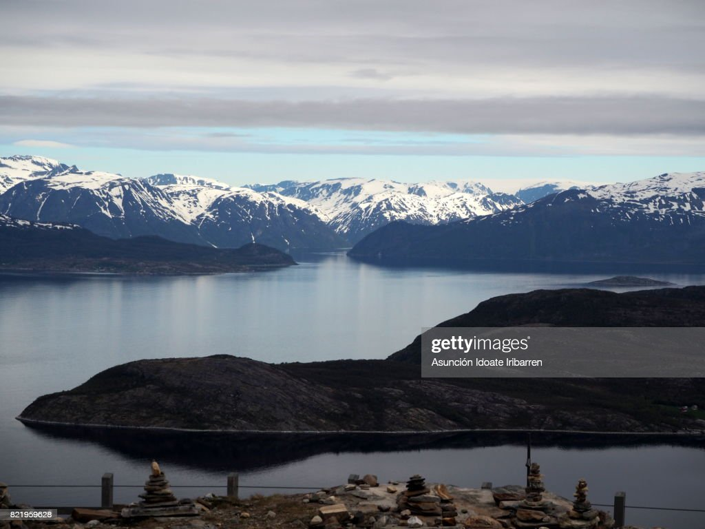 Cairns on the edge of the fjord : Stock Photo