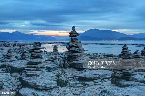 Cairns on the shoreline of Sirmione
