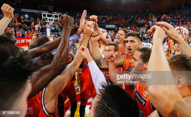 Cairns players celebrate during the round six NBL match between the Cairns Taipans and Melbourne United at Cairns Convention Centre on November 9...