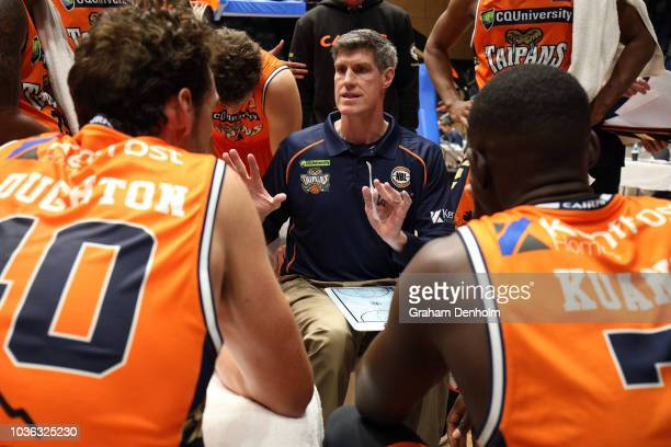 Cairns Taipans Head Coach Mike Kelly talks to his players during the NBL Blitz pre-season match between the Sydney Kings and Cairns Taipans at...