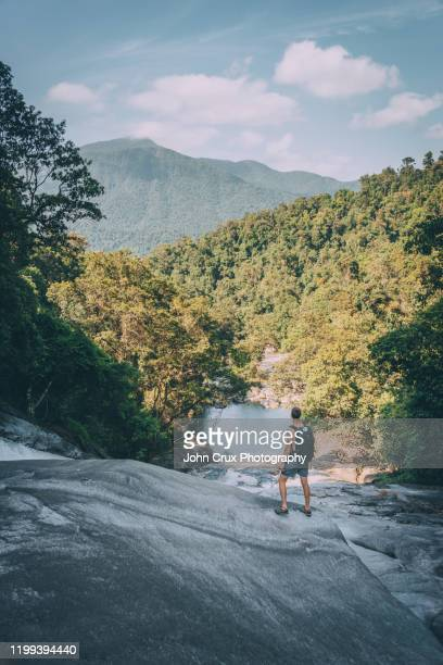 cairns waterfall hiker - cairns stock pictures, royalty-free photos & images