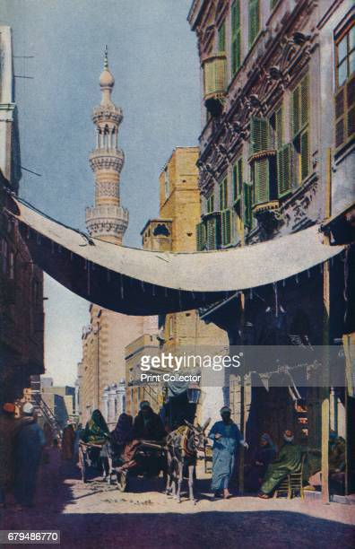 Cairo. Balconies, carved woodwork, and tapering minarets give an endless diversity to Cairo's awning-shaded native streets', c1920. Cairo is the...