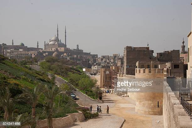 Salah AlDin walls restauration in old Cairo in the Distance Muhammad Ali mosque on the citadel