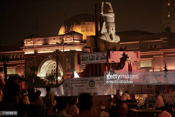 A replica Ramses II statue is moved in a trial run in alTahrir square in Cairo early 28 July 2006 in a bid to guarantee maximum safety during next...