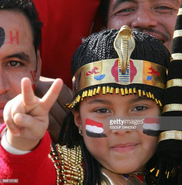 Young fan of Egypt's Pharaohs national team flashes the V-sign for victory as the 74,000-capacity Cairo International Stadium fills up for the final...