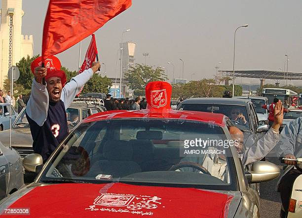 An AlAhly fan cheers from inside a car upon the team's arrival from Japan to the VIP terminal in Cairo 19 December 2006 after their participation in...