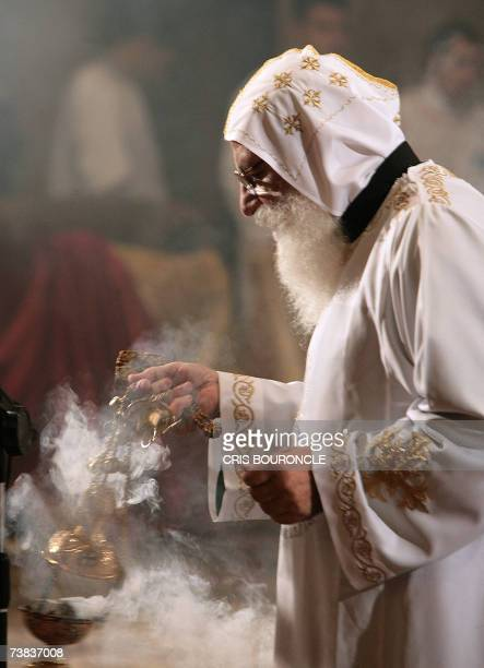 An Egyptian Copt monk burns incense prior to the Coptic Easter celebration mass directed by His Holiness Pope Shenouda III the 117th Pope of The...