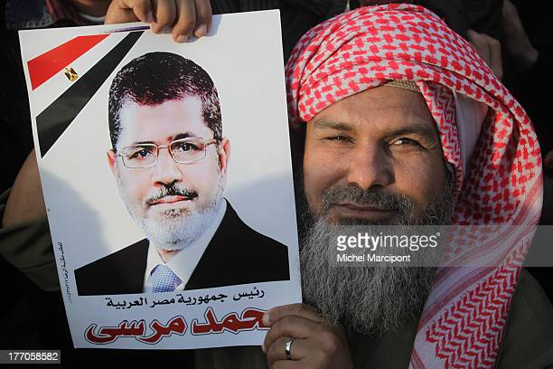 CONTENT] cairo Egypt Brotherhood and Islamist allies gather at Cairo University for mass rally in support of President Morsi's contentious...