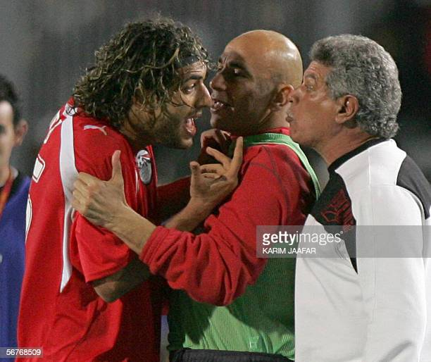 Egypt star striker Ahmed 'Mido' Hossam player in Tottenham argues with Egyptian coach Hassan Shehata after he was taken out from the field during an...