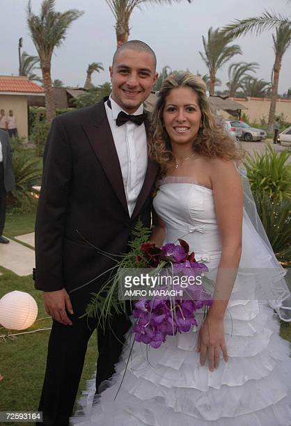 Egyptian actor Amad alFishawi and his bride Wissam pose for a picture during their wedding ceremony at the villa of his father actor Faruq alFishawi...