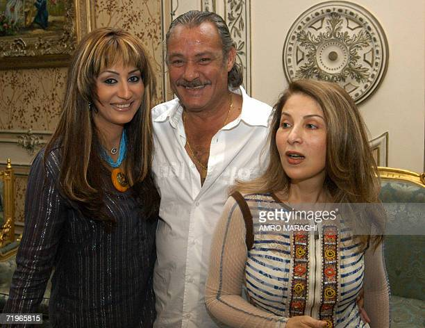 Egyptian actor Faruq alFishawi smiles as he poses with Egyptian actresses Wafaa Amer and Poussy at Studio Nile in Cairo during the production of...