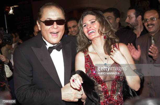 Egyptian actor Mahmud Abdel Aziz shares a light moment with fellow film star Yusra at the opening ceremony of the 30th Cairo International Film...