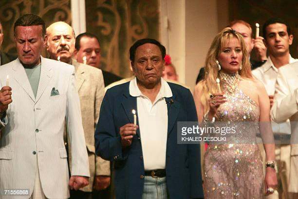 Egyptian comedian Adel Imam and other actors hold candles after the end of his play Bodyguard at alZaeem theater in Giza early 01 August 2006 in...