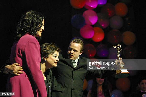 Egyptian director Magda abdel Aziz receives the award of the best children TV program Hearts Love You at the closing ceremony of Cairo's 16th...