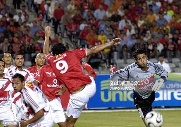 Egyptian goal keeper of alZamalek club Abd alMunsef reaches for the ball at Cairo stadium 16 June 2006 during the final match of the Egyptian yearly...
