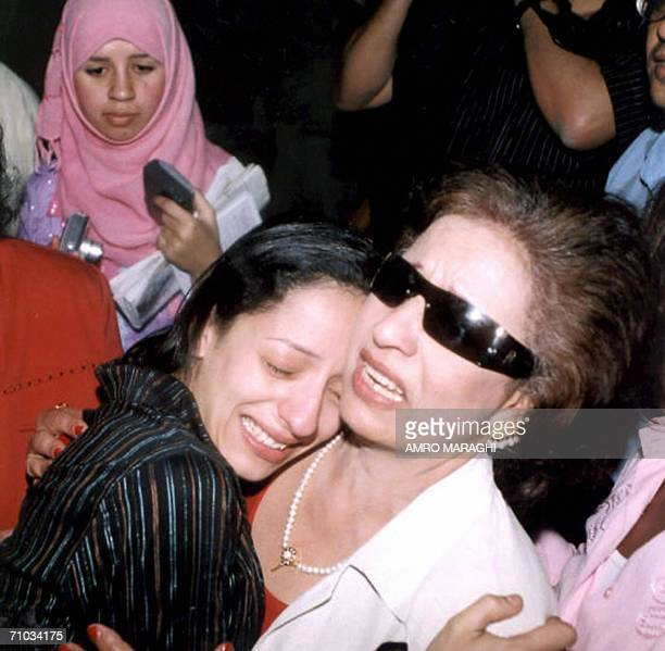 Egyptian Hind Hennawi cries as she hugs her mother after she won the parental suit against actor Ahmad alFishawi 24 May 2006 in Cairo The judge...