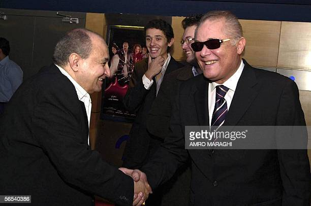 Egyptian movie star Mahmud Abdel Aziz shakes hands with scriptwriter Wahid Hamed during a special screening for Hamed's new movie Damm elGhazal...
