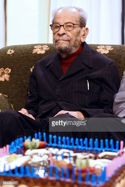 Egyptian novelist and 1988 Nobel prize winner in Literature Naguib Mahfouz celebrates his 94th birthday at a hotel in Cairo late 14 December 2005...