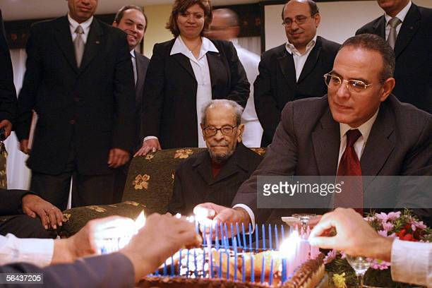 Egyptian novelist and 1988 Nobel prize winner in Literature Naguib Mahfouz celebrates his 94th birthday among friends at a hotel in Cairo late 14...