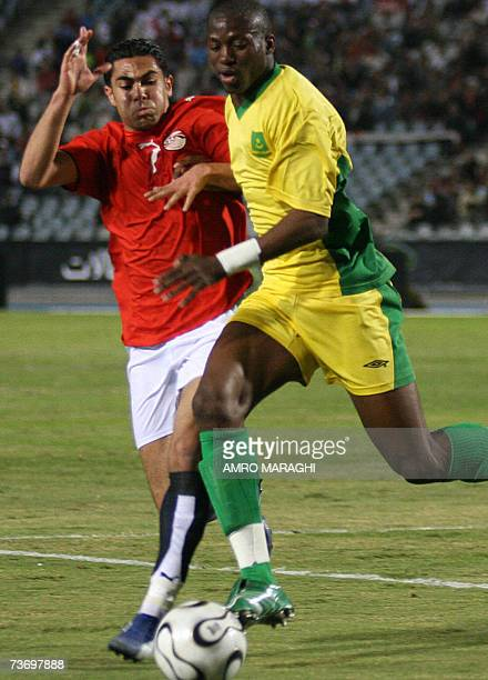 Egyptian player Ahmad Fathy fights for the ball with Mauritania's player Kamara Abd AlAzez during their African Cup of Nations qualifier football...