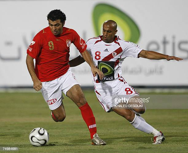 Egyptian player of alAhly club Imad Meteb vies for the ball with Alaa Abdelghani of Zamalek club during the final football match of Egypt's Cup in...