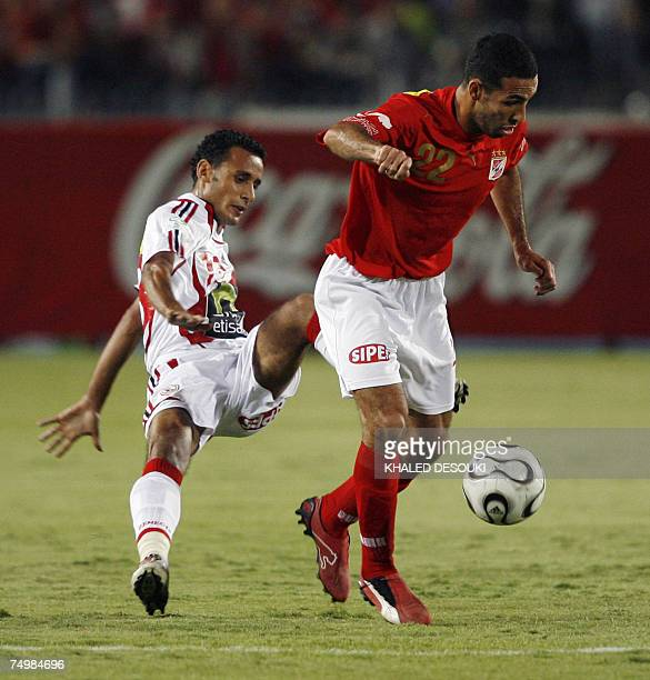 Egyptian player of alAhly club Mohammed Abutrika vies for the ball with Tarek alSaid of Zamalek club during the final football match of Egypt's Cup...